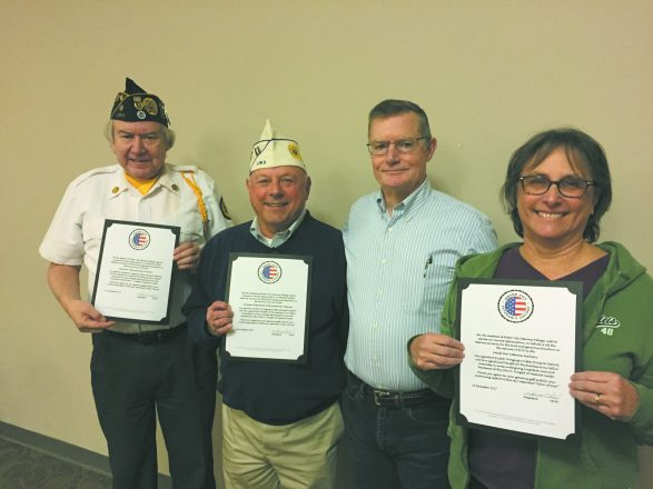 Jewish War Veteran members Marc Manson, JWV Memorial Home; Larry Berry, Commander, JWV Department of Michigan; and Linda Zyla, JWV Lt. Raymond Zussman Auxiliary #333, hold letters of appreciation from Motor City Veteran's Village signed by its president and JWV member Ret. Brig. Gen. Donald Schenk (in striped shirt).