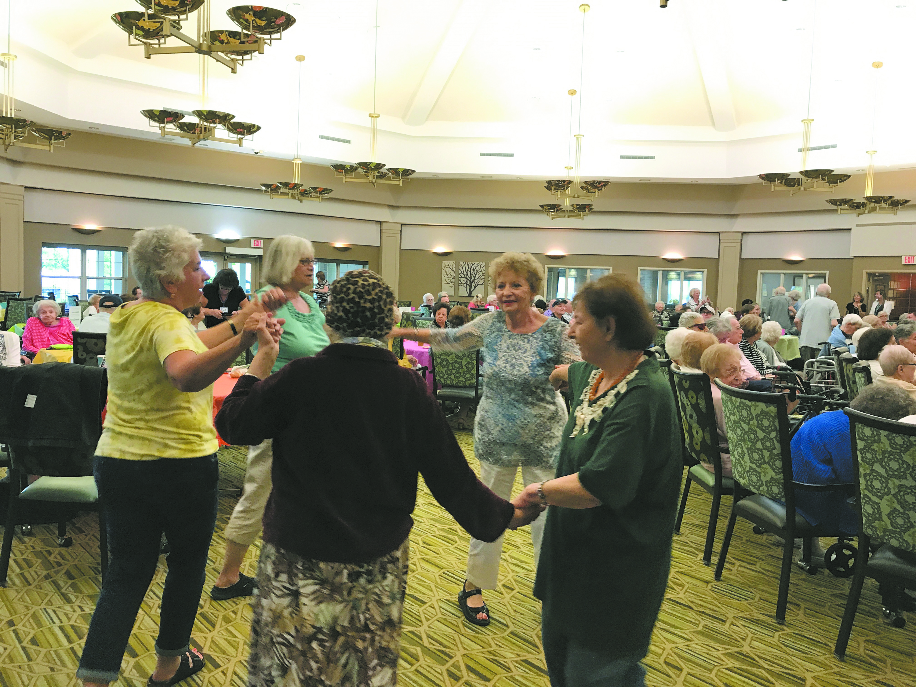 Survivors and second-generation family members dance at a Café Europa event hosted by the Program for Holocaust Survivors and Families