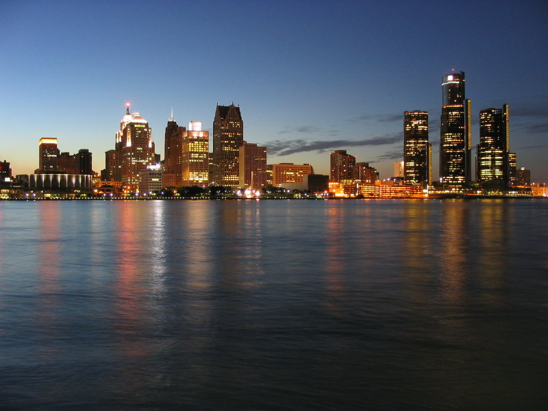 The Detroit Skyline shows Detroit at night on the Detroit river for blogger Hannah Gordon's slightly alcoholic blog on Craft Work in Detroit's West Village all about happy hour.