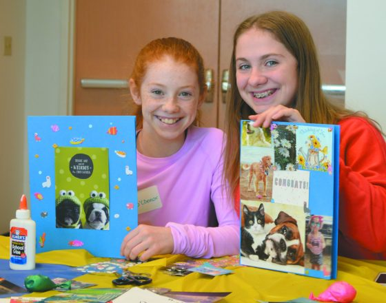 Emmy and Ali O'Connor show off their decorated journals.