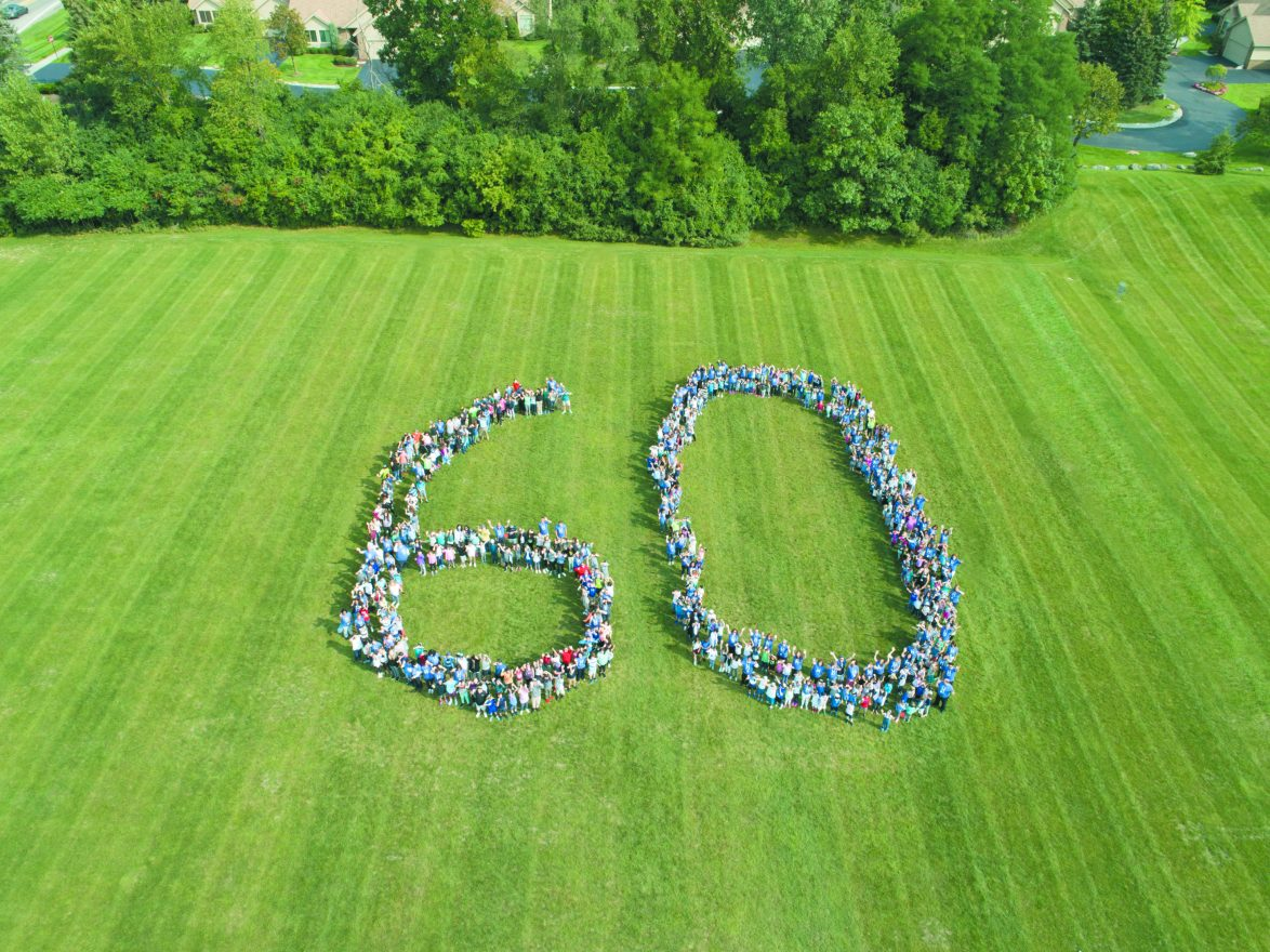 Hillel students, faculty and staff spell out 60 in honor of the school's 60th anniversary.