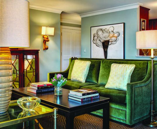 Strickland chose a high-back settee as the focus of this room.