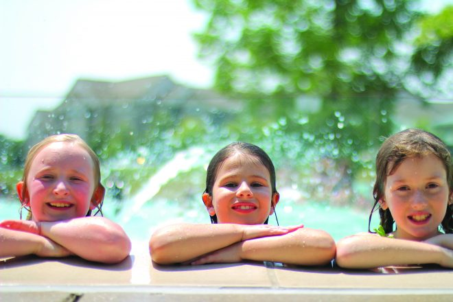 JCC day campers enjoy a cooling dip in the pool.