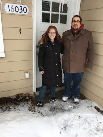 Leslie Rott and fiance Derrick in front of their house. Leslie shares her engagement story in the love and relationships blog. blogger. writer.