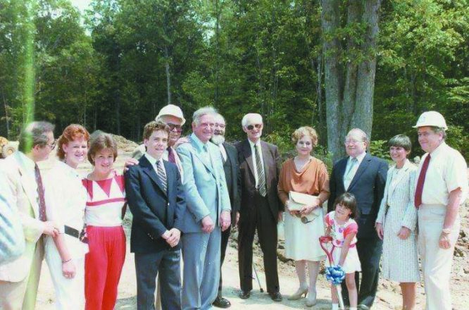 Ground-breaking for renovations at the Farmington Hills campus, 1985; pictured are members of the Must, Davidson and Hermelin families with Rabbi Robert Abramson and Anaruth Bernard.