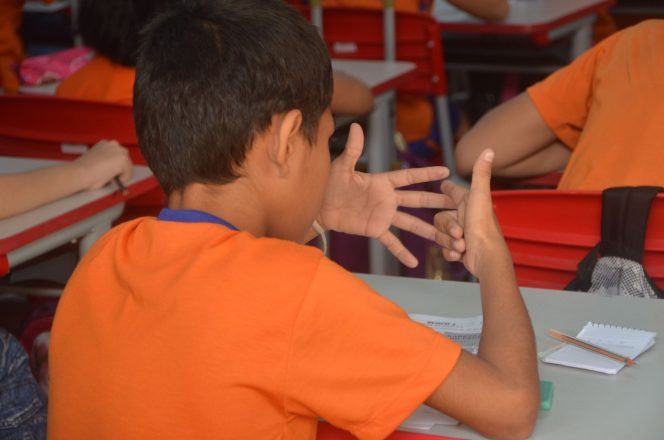 child counting fingers to show in the census that everyone counts