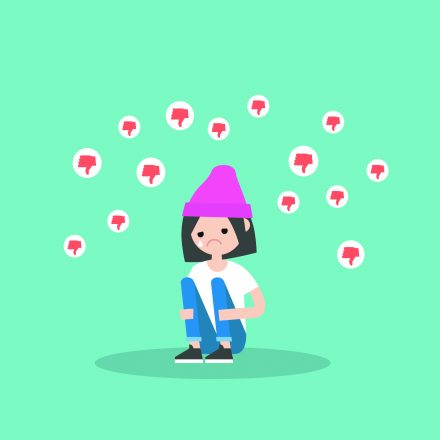 Upset crying girl sitting and hugging her knees surrounded by the dislike symbols / editable flat vector illustration, clip art