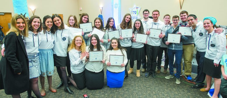 Bnei Akiva students are recognized.