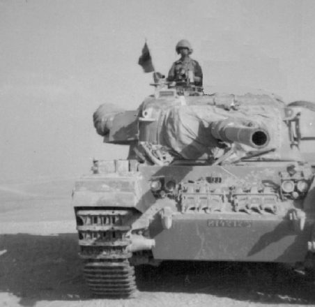 Arik Ragowsky of Farmington Hills, tank commander, 1970-1973; photo taken during Yom Kippur War just before crossing the Suez Canal.
