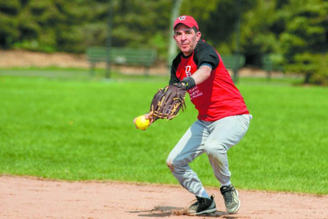 Joe Bernstein of the Temple Kol Ami/B'nai Israel Synagogue team gets ready to throw the ball.