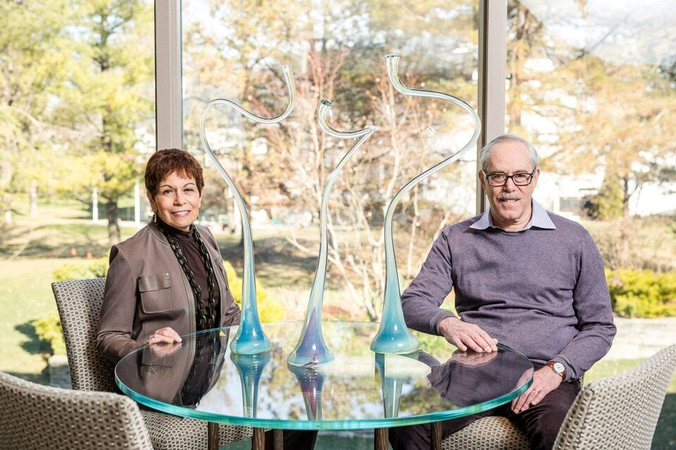 Sandy and Jim Danto sit with a prized piece by Harvey Littleton, a pioneer in the Glass Art Movement.