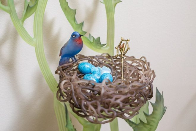 A bird's nest by Janis Miltenberger sits in a glass chair (not shown).
