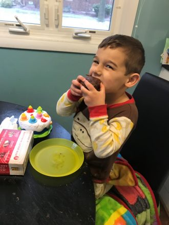 """C takes the first bite of our """"healthier"""" chocolate chip muffins. Cooking with Kids blogger, blog"""