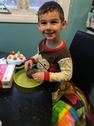 """C smiles with his muffin. """"healthier"""" chocolate chip muffin. cooking with kids blogger blog."""