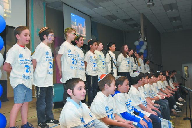Elementary school students perform during event.