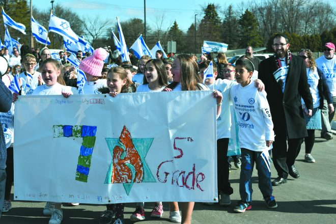 The entire school population marched from the school's entrance up 12 Mile Road.