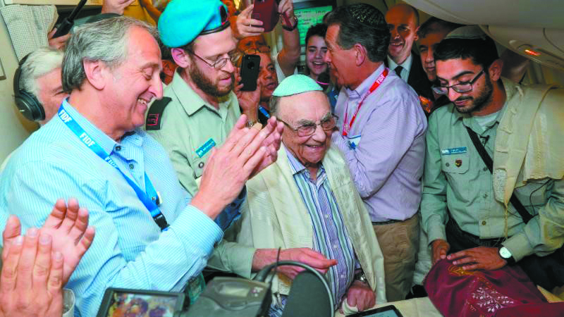 Auschwitz-Birkenau survivor Leon Shear celebrated his bar mitzvah on the FIDF flight from Poland to Israel on April 16. Photo by Shahar Azran