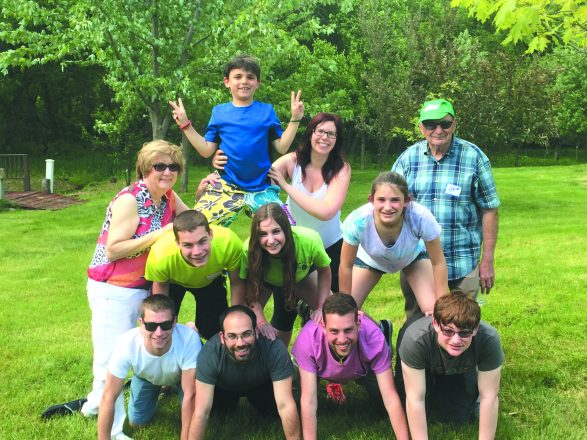 Lorraine and Arnie Fisher flank their grand-children on the Willoway Day Camp Nature Trail. Bottom row: Alex Vieder, Brandon Vieder, Adam Fisher and Ben Fisher. Middle Row: Nick Vieder, Kaitlin Fisher, and Jessie Fisher. Top Row: Daniel Fisher and Meryl Vieder.