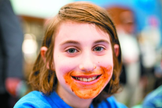 Elan Rosenberg, 10, of West Bloomfield after finishing a rib