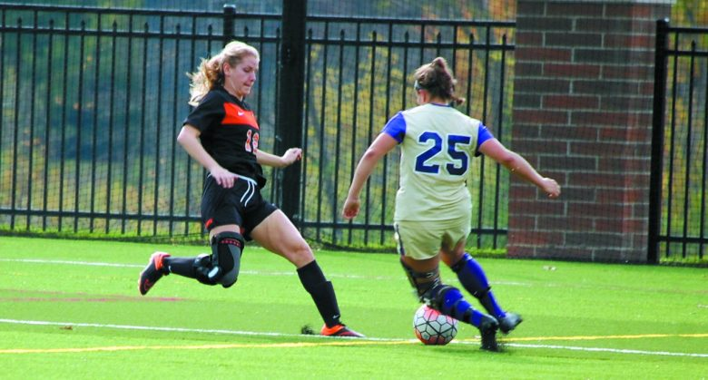 Kalamazoo College defender Allie Brodsky (left) challenges an opponent.