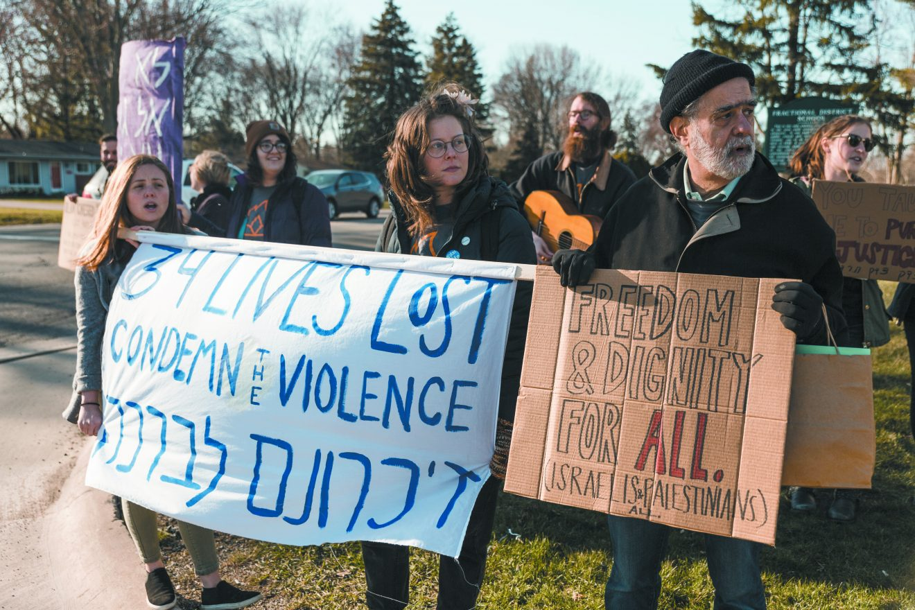 IfNotNow Detroit members hold a demonstration at Hillel Day School April 19. Photo by Sam Siegel