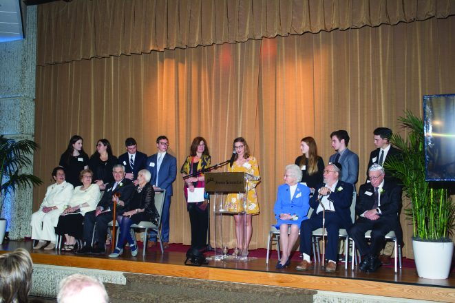 Presenter and FJA student Aviva Levi on stage with the 2018 honorees