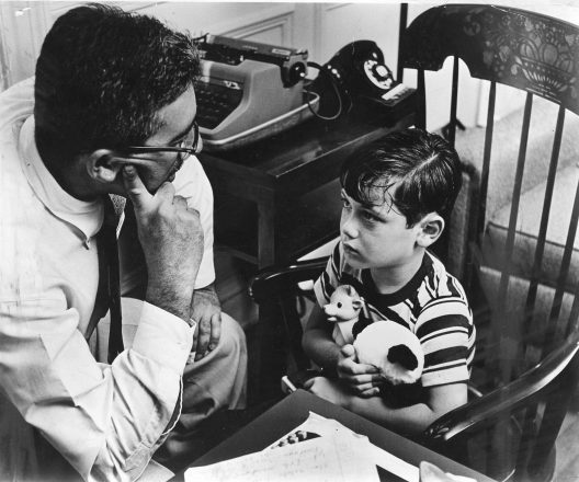 Then: A counselor speaks with a young boy.