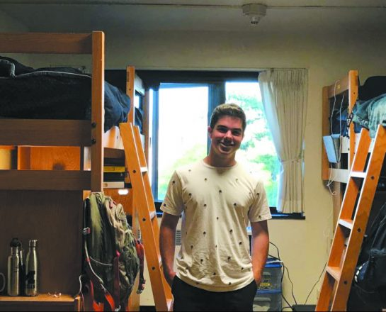 U-M student Paul Schmitz in his dorm room