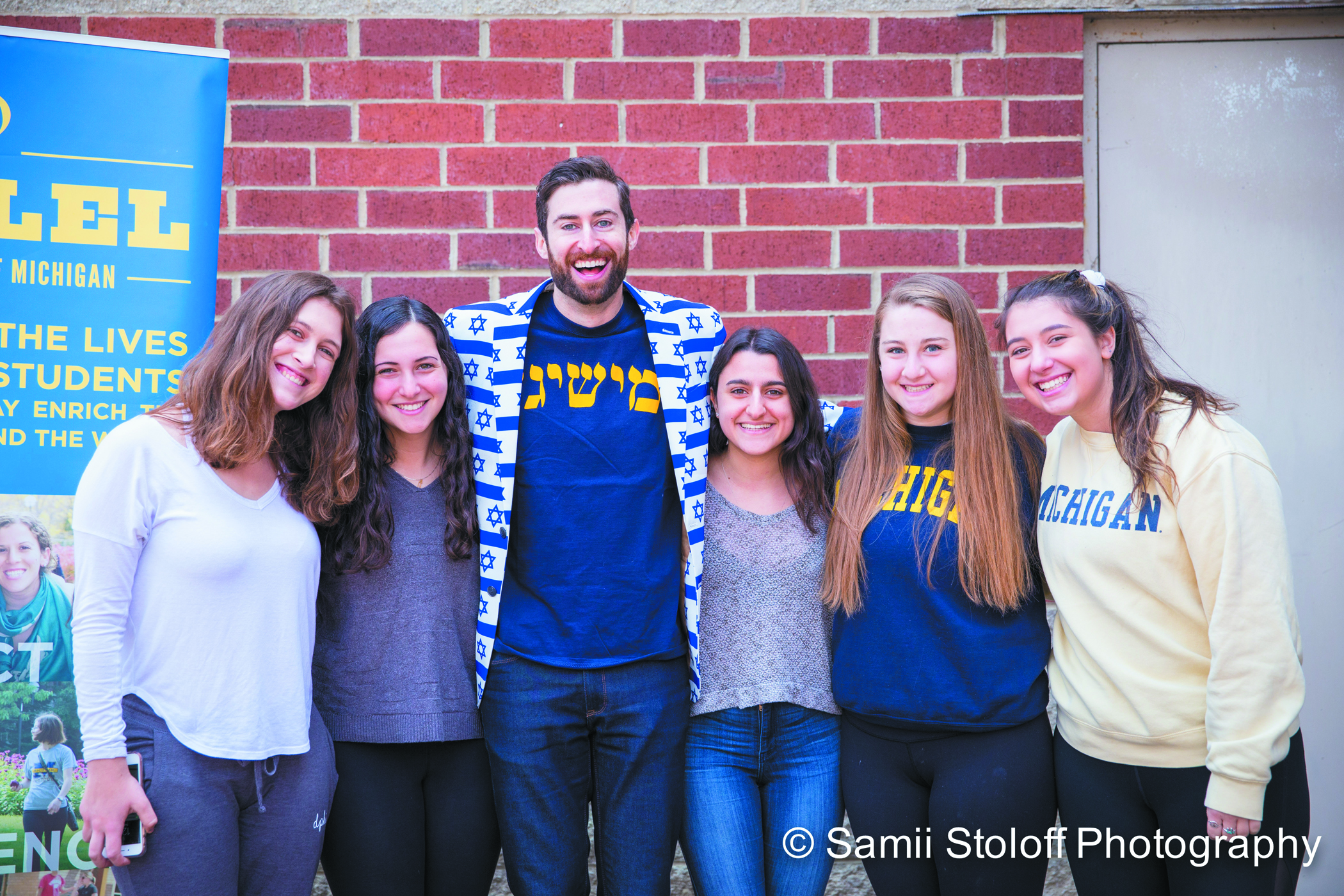 Freshmen Sarah Wish, Allison Bloomberg, Rebecca Levy, Vanessa Freedman and Rachel Klein gather for a picture with comedian and HQ trivia host, Scott Rogowsky, after University of Michigan Hillel's Leadership Brunch; he also spoke to a crowd of more than 350 people at the Michigan Union.