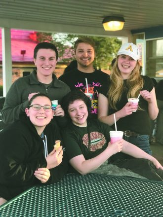 Albion Hillel students enjoy an ice cream break before finals: (top) Evan Ziegelman of Wixom, Michael Bernard of Grand Blanc and Karissa Bush of Grand Haven; (bottom) Adrianna LeDonne of La Porte, Ind., and Mickey Benson of Portland, Ore.