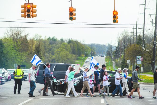 Police handle traffic on Orchard Lake Road so marchers can pass safely.