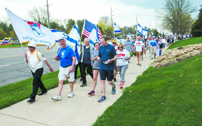 Walkers head up Orchard Lake to show their support for Israel.
