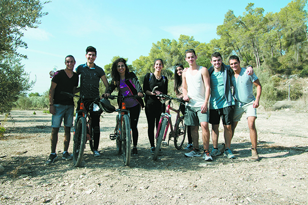 Central Galilee 11th-graders comingle on the Naim BeYahad bike trail.