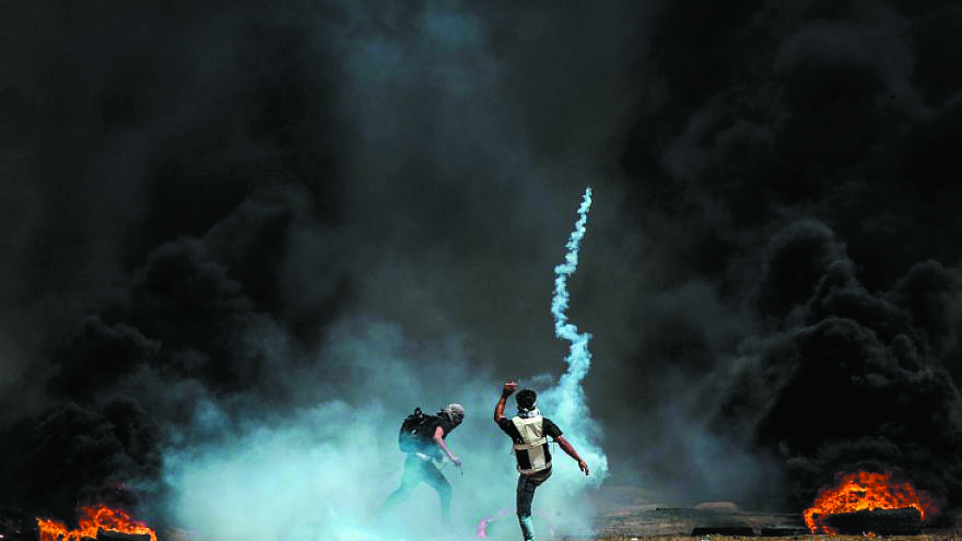 Palestinian protesters during clashes with Israeli forces along the border with the Gaza strip east of Gaza City on May 11, 2018.