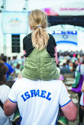 Israel@70. Mia Levine, 7, sits on the shoulders of her father, Josh Levine of Huntington Woods, for a better view of the music on stage.