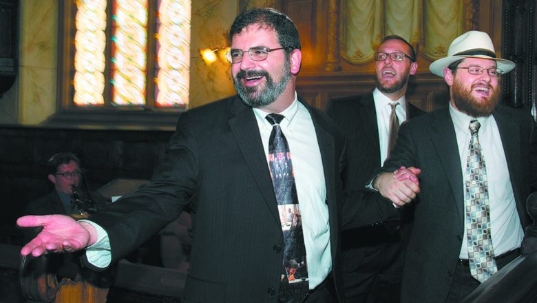 In 2015, Rabbi Asher Lopatin, left, dances with Rabbi Raif Melhado, Yeshivat Chovevei Torah 2015 graduate, and Rabbi Ysoscher Katz, chair of the Talmud department at YCT in Riverdale, N.Y. Lopatin headed the yeshiva, but ended his tenure recently and is moving to Detroit.