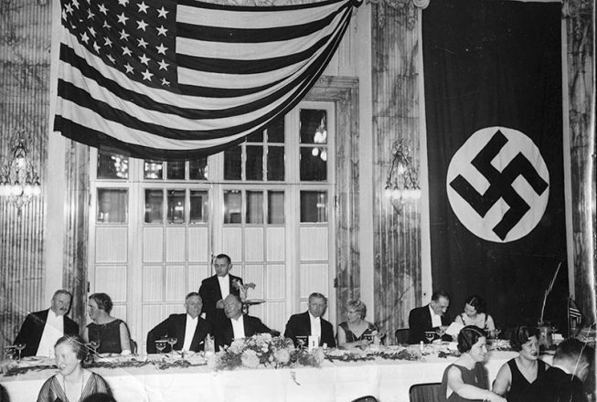 American diplomats in Germany were well aware of the Nazi persecution of Jews, but the U.S. government respected Germany's right to govern its own citizens. U.S. Ambassador William Dodd (in front of waiter) celebrates Thanksgiving at the Hotel Esplanade in Berlin, 1934.