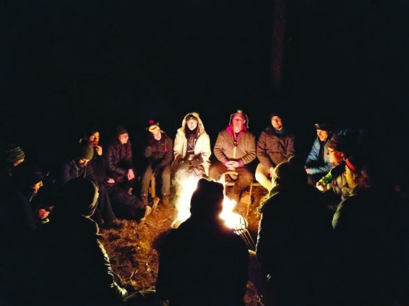 At night around the camp fire, staff and campers check in and discuss weekly goals.