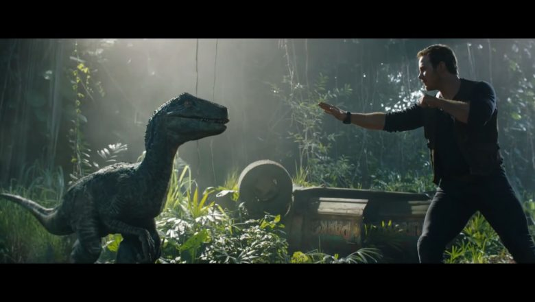 Still from the movie Jurassic World: Fallen Kingdom. Chris Pratt and a dinosaur.