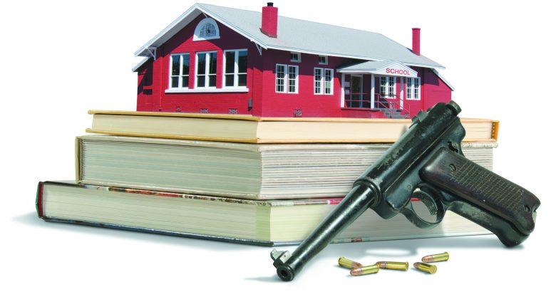 Guns in school concept showing red brick old fashion schoolhouse on a stack of educational school books with guns and bullets. Gun violence