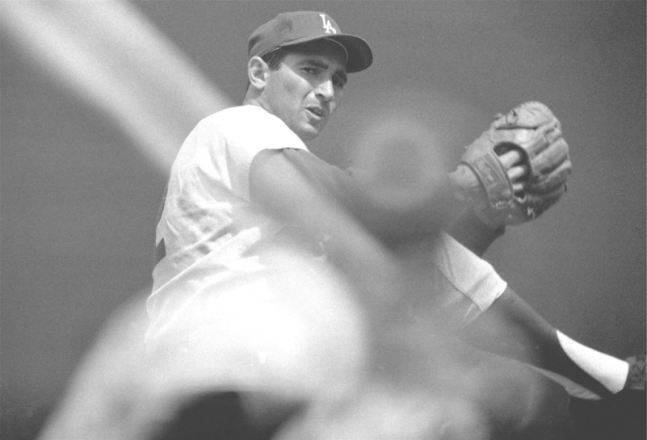 Any Jewish baseball fan who knows his stuff knows that Los Angeles Dodger Sandy Koufax sat out Game 1 of the 1965 World Series because it fell on Yom Kippur (an example set by Detroit Tiger Hank Greenberg in the 1935 World Series). Morrison Hotel Gallery will custom print this photograph of Sandy Koufax by Neil Leifer (price upon request), captured on Aug. 22, 1965, as Dodger Koufax winds up during a game against the San Francisco Giants at Candlestick Park. (212) 941-8770; morrisonhotelgallery.com. PHOTO BY neil leifer / sports illustrated. Father's Day Gift.