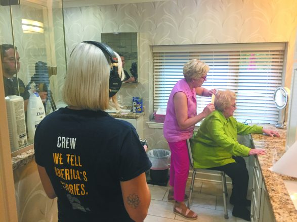 Cathy Deutchman of Franklin helps her mother fix her hair; crew members were filming the interaction.