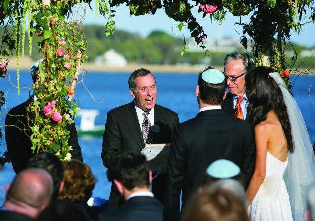 Larry Bacow officiated at the wedding of Randi Spoon and Mike Evelson, the youngest daughter of his friends, Alan and Terri (Alper) Spoon. Bacow officiated at the weddings of all three Spoon children, Randi, Ryan and Leigh.