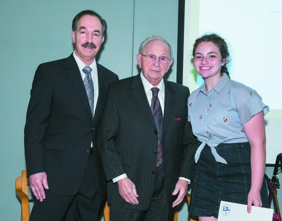 Irvin and Garry Kappy with Hannah Wise, a Roeper student who placed third in fiction writing