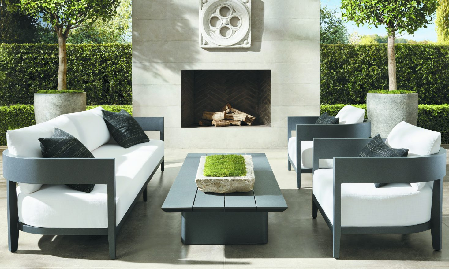 The modern, minimalist lines of Restoration Hardware's BALMAIN COLLECTION (including sofa, lounge chair and coffee table) are softened by sleek curves. RH.com. outdoor decorating.
