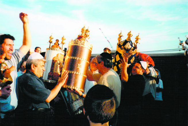 In 2002, the synagogue's Torahs come to their new home.