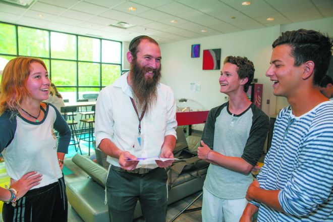 UMatter volunteers Leah Dunn, Rabbi Yarden Blumstein, Benny Fellows and Mac Bauer share a moment at Friendship Circle.
