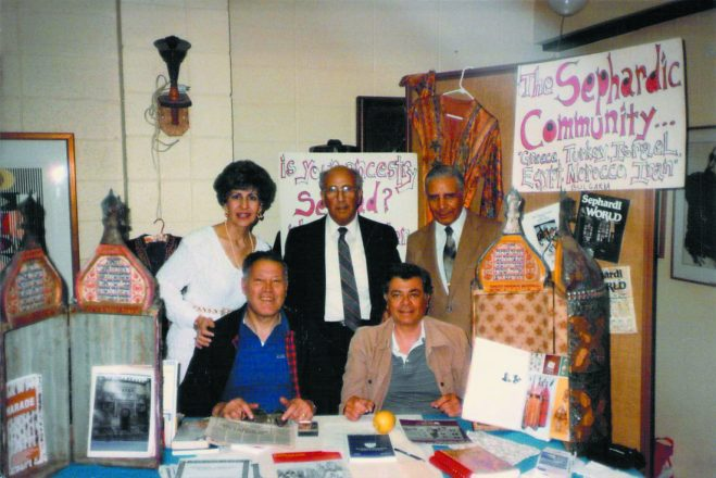 Members of Keter Torah display information about Detroit's Sephardic community in the 1980s.