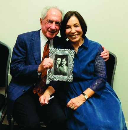 Harold and Penny Blumenstein display a 1933 photo of his parents, Hyman and Sonia Blumenstein — hardworking European immigrants who built a loving family life in Metro Detroit./Credit: Dena Borsand