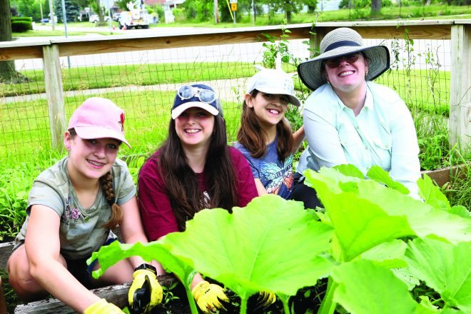 Elana Harr, Jocelyn Adelman, Shoshanna Harr and Barrett Harr, all of Farmington Hills, joined more than 40 volunteers during Kadima's Gardening Day, presented by Wallside Windows.